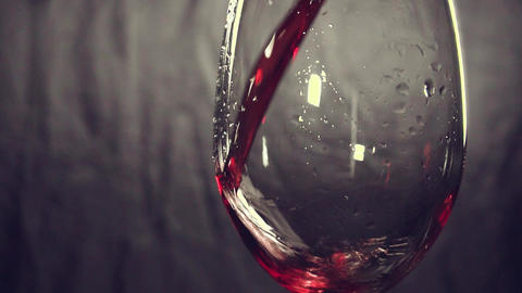 slow motion, pouring wine, glass, dark background ビデオ