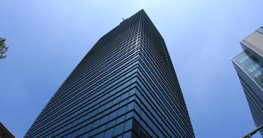 Building in the blue sky at west Shinjuku low angle ビデオ