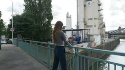Young Woman Standing on Bridge in Industrial Area 영상물