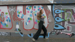 Young Woman Dancing in Front of Murals Footage