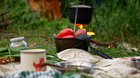 Cooking outdoor food in tourist pot at bonfire. Process preparing camping food Footage