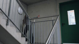 Young Woman Dancing on the Steps of an Emergency Stairwell Footage