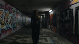 Young Woman Walking in an Underground Passageway Footage