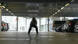Young Woman Dancing in an Indoor Parking Lot ビデオ