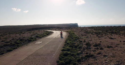 Man And Woman Riding Small Motorcycle In Lampedusa Italy Footage