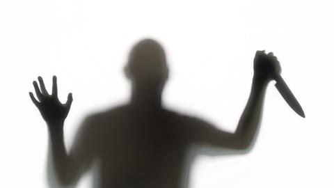 Silhouette of a Knife Wielding Killer Live Action