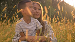 Loving asian family, cute boy and his mother talking happily and pointing while ビデオ