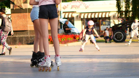 Two young girls learn to skate. Friendship and fun Live Action