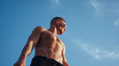 Sexy man in sky background Live Action