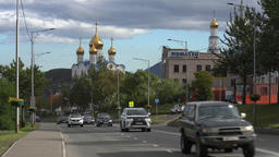 Traffic flow of cars along road on background of Holy Trinity Orthodox Cathedral GIF