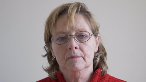 Middle aged woman looking at camera with serious expression Footage
