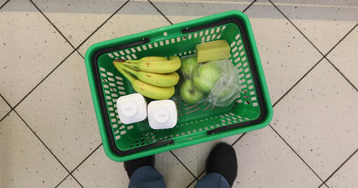 Woman with food basket at grocery store or supermarket 영상물