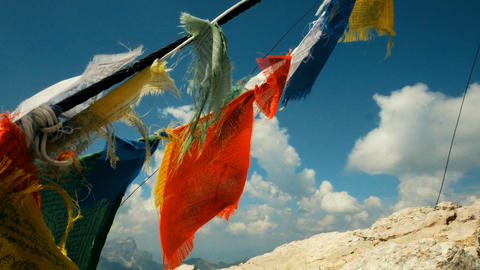 Tibetan flags waving on a mountain top in South Tyrol Footage