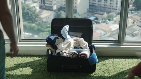 Travellers packing bagagge for summer vacation Footage