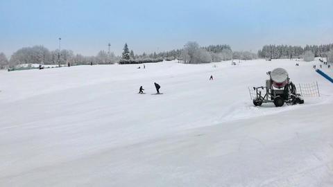 Parents teach child to ski on skiing downhill at ski resort Archivo