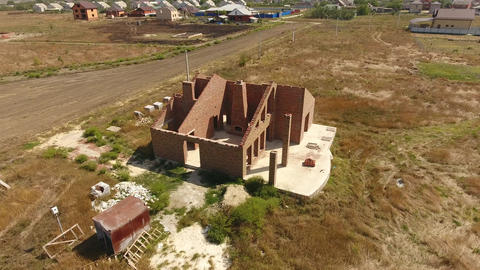 The house is built of red brick. The walls of the house are a top view Footage