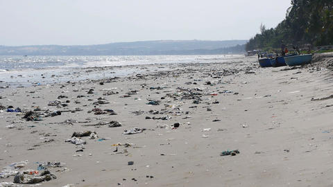 Pan shot of plastic garbage and trash on the beach. static shot Live Action