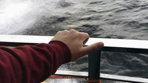 Hand on the railing of a yacht against the background of sea water 영상물