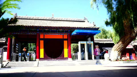 Time lapse shot at the entrance of a Buddhist temple 01 GIF