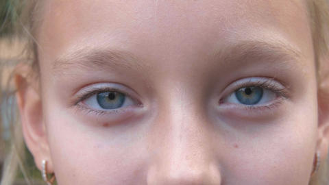 Young girl with closed eyes closeup. Face girl with gray eyes looking in camera Footage