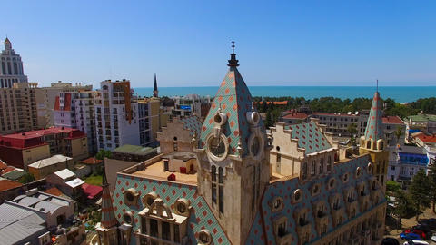 Beautiful building against cityscape with sea at horizon, luxury hotel in Batumi Footage