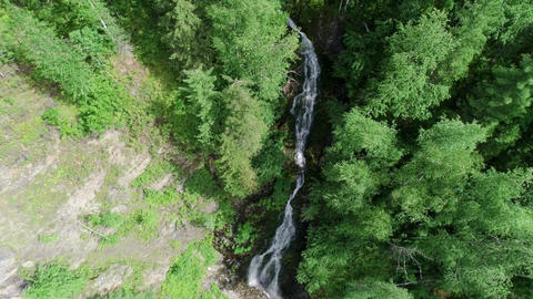 Waterfall in the forest Panoramic aerial view. Summer weather, taiga nature, GIF