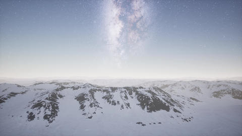 aerial view of Milky Way above snow covered terrain ビデオ