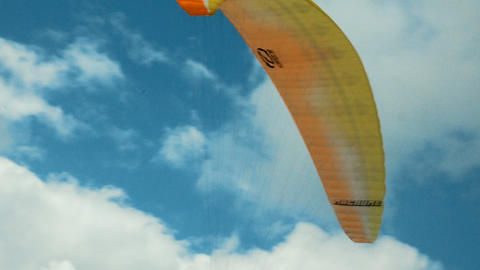 paraglider flies over a mountain top in South Tyrol GIF