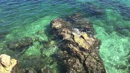 France Cote d'Azur Villefranche sur Mer rock inside turquoise water ビデオ