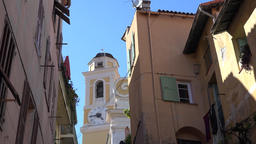 France Cote d'Azur Villefranche sur Mer yellow church tower between old houses Footage