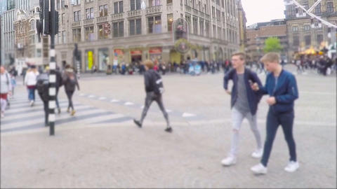 Dam Square Crowd and Tram Traffic Live Action