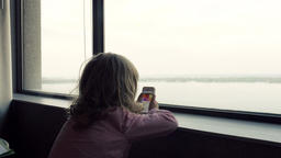 Lake Ontario and a Little Girl Watching Cartoons on a Smartphone Footage
