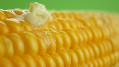 Tasty fresh piece of butter melting on ripe yellow fresh... Stock Video Footage