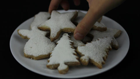 Hands taking Christmas cookie Footage