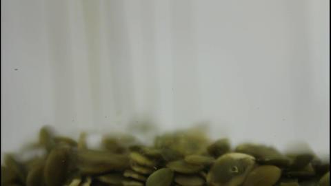Pumpkin seeds falling Stock Video Footage