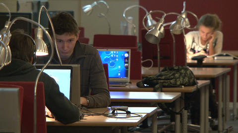Students in the library for computers Footage