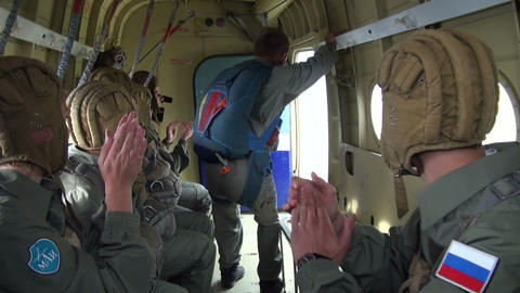 Military parachutists jump out of the plane Footage