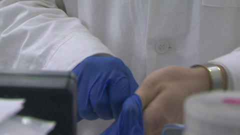 Laboratory assistant wear rubber gloves Stock Video Footage