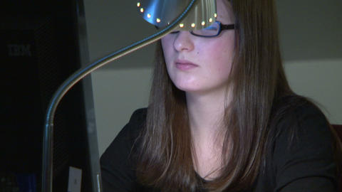 A student in the library on the computer Stock Video Footage