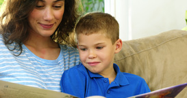 Mom and son looking at a book Footage