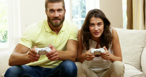 Happy couple playing video games Footage