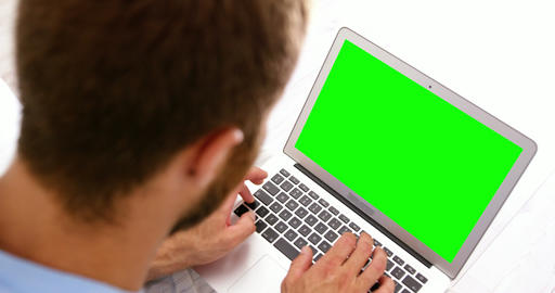 Close up of man using a laptop Live Action
