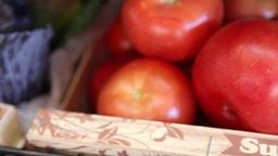 basket of tomatoes on display in supermarket, slider shot Footage