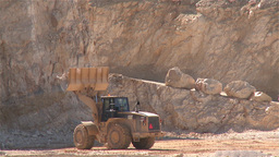 Heavy Building Bulldozer waiting for dump truck in a quarry Footage