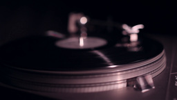vinyl record playing in turntable, slider shot Footage
