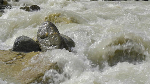 Very fast mountain river, close-up GIF