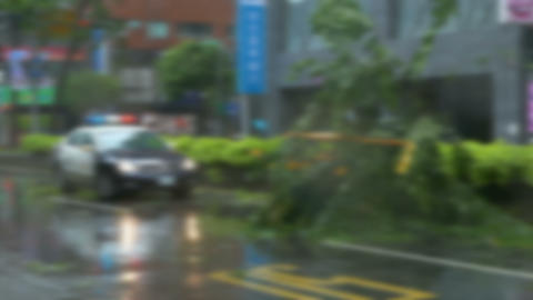 Blur and stabilised police car - typhoon background Footage