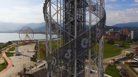 Alphabetic tower in Batumi Georgia against Black Sea and seafront area, culture Live Action