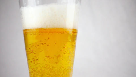 Beer glass close-up. In a glass of beer foam and bubbles in slow motion Footage