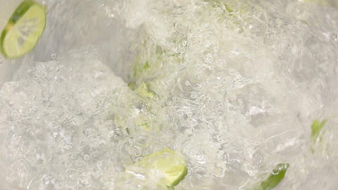 Lime slice and mint into water swirling slow motion 영상물